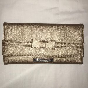 Nine West gold wallet with bow